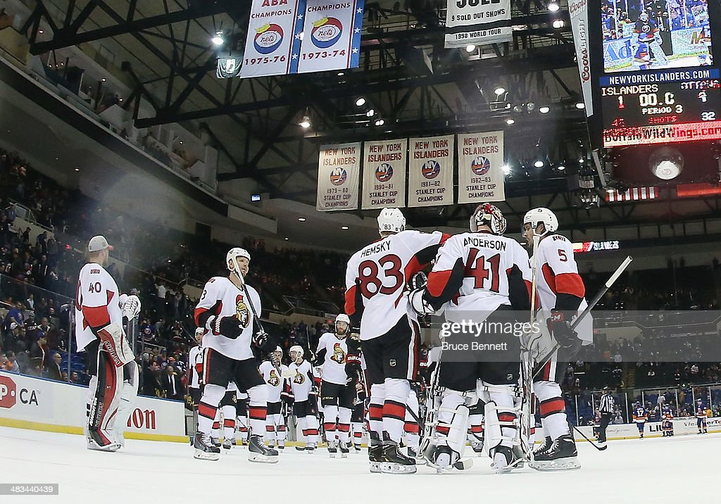 The Ottawa Senators celebrate their 4-1 victory over the New York Islanders at the Nassau Veterans Memorial Coliseum on April 8, 2014 in Uniondale, New York.
