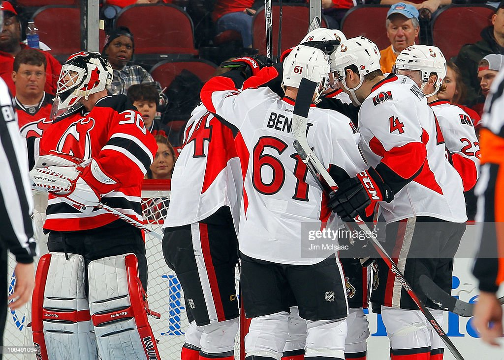 The Ottawa Senators celebrate their first goal of the game against <a gi-track='captionPersonalityLinkClicked' href=/galleries/search?phrase=Martin+Brodeur&family=editorial&specificpeople=201594 ng-click='$event.stopPropagation()'>Martin Brodeur</a> #30 of the New Jersey Devils at the Prudential Center on April 12, 2013 in Newark, New Jersey.