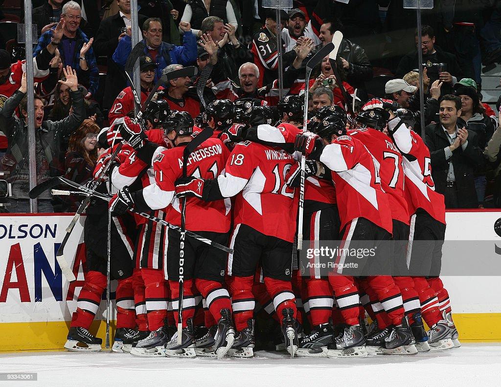 The Ottawa Senators celebrate their overtime win against the Washington Capitals at Scotiabank Place on November 23 2009 in Ottawa Ontario Canada