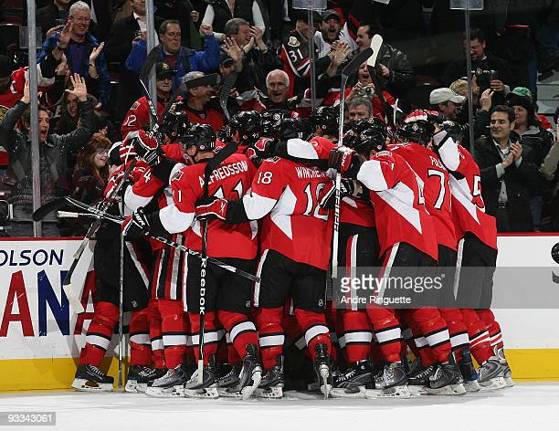 The Ottawa Senators celebrate their overtime win against the Washington Capitals at Scotiabank Place on November 23 2009 in Ottawa Ontario Canada