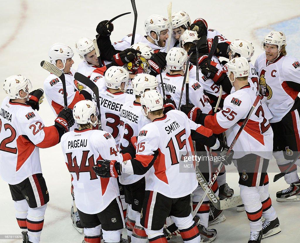 The Ottawa Senators celebrates following a 2-1 overtime victory over the Washington Capitals at the Verizon Center in Washington, D.C., Thursday, April 25, 2013.