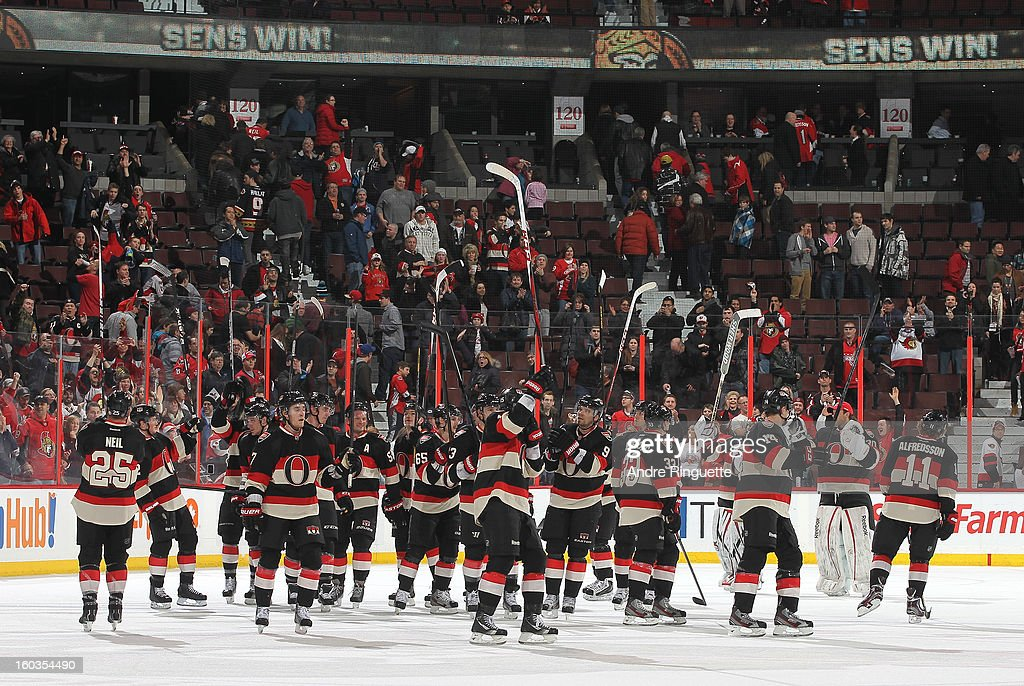 The Ottawa Senators raise their sticks in celebration after a 3-2 come-from-behind win over the Washington Capitals on January 29, 2013 at Scotiabank Place in Ottawa, Ontario, Canada.
