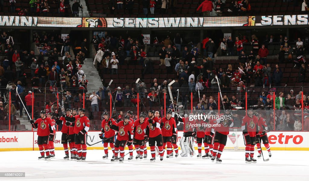 The Ottawa Senators raise their sticks, saluting fans, after their win against the Buffalo Sabres at Canadian Tire Centre on December 12, 2013 in Ottawa, Ontario, Canada.