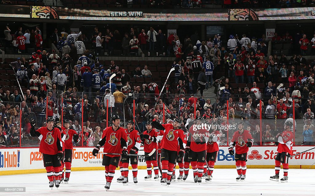 The Ottawa Senators raise their sticks to salute their fans after a win against the Toronto Maple Leafs on the last home game of the season at Canadian Tire Centre on April 12, 2014 in Ottawa, Ontario, Canada.