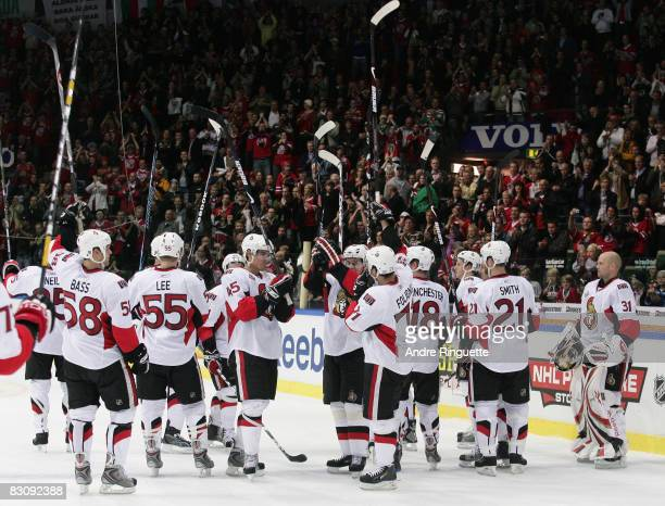 The Ottawa Senators salute fans of the Frolunda Indians at Scandinavium Arena upon completion of their game on October 2 2008 in Gothenburg Sweden