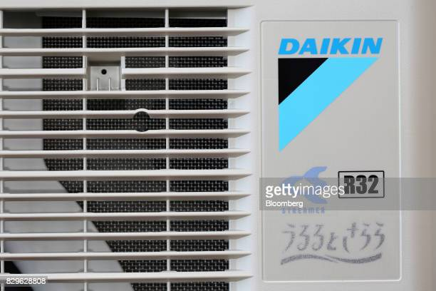 The outdoor unit of a Daikin Industries Ltd R32 inverted split type air conditioner stands at the company's Shiga plant in Kusatsu Shiga Japan on...