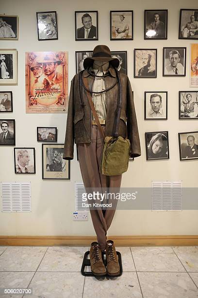 The outfit worn by Harrison Ford in the film Indiana Jones is displayed near actors' headshots and movie stills at Angels Costume House on January 20...