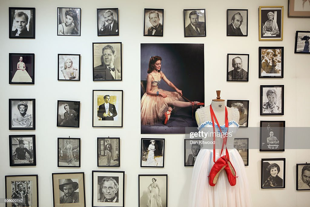The outfit worn by Moira Shearer in the film Red Shoes is displayed near actors' headshots and movie stills at Angels Costume House on January 20, 2016 in London, England. Angels Costumes established in 1840 is in its 175th year, and is the longest-established and largest professional costume house in the world. The costumier is to receive the 'Outstanding British Contribution to Cinema Award' at the EE British Academy Film Awards ceremony at Londons Royal Opera House on Feb 14, 2016.
