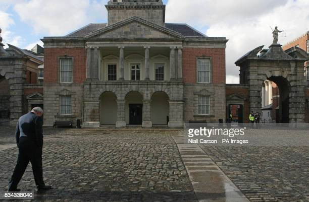 The outgoing Irish premier Bertie Ahern left waits to greet the former British Prime Minister Tony Blair to a meeting at Dublin Castle which forms...