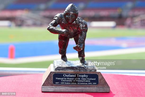 The Outland Trophy sits on a table during a college football game between the Penn Quakers and the Ohio Dominican Panthers on September 16 2017 at...