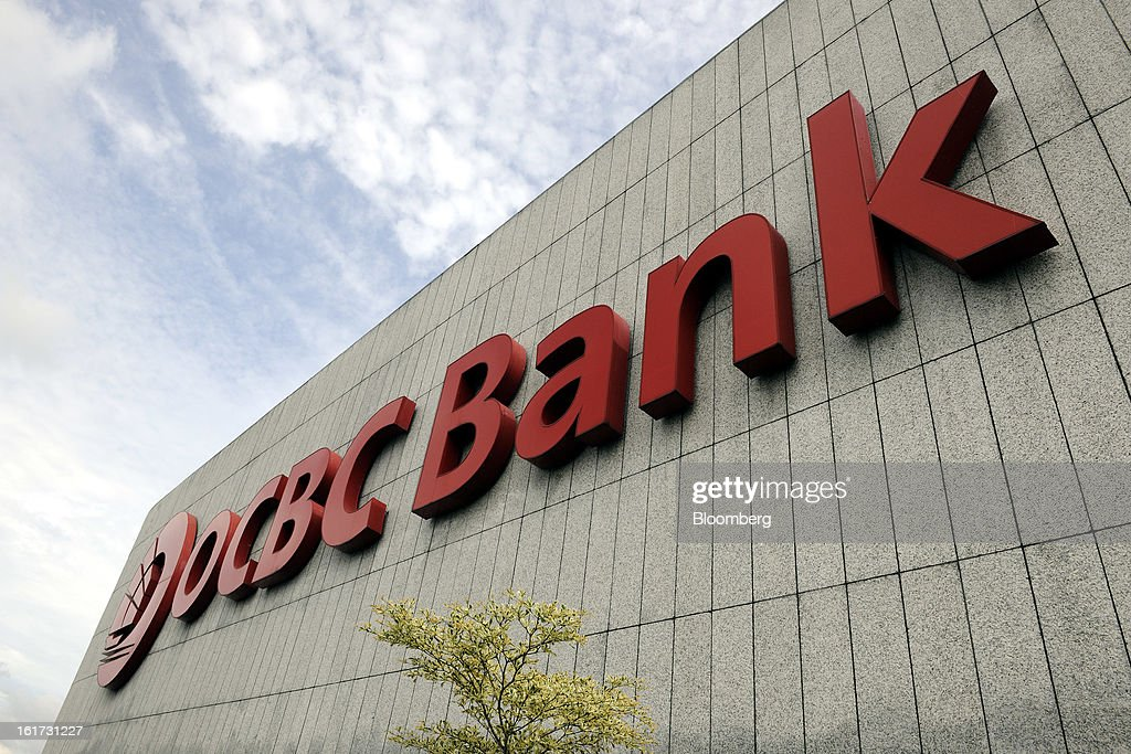The Oversea-Chinese Banking Corp. (OCBC) logo is displayed atop the OCBC Centre, viewed from the building's observation deck, in Singapore, on Friday, Feb. 15, 2013. OCBC, Southeast Asia's second-largest lender, posted a 12 percent gain in fourth-quarter profit as higher income from wealth management and insurance offset narrowed lending margin. Photographer: Munshi Ahmed/Bloomberg via Getty Images