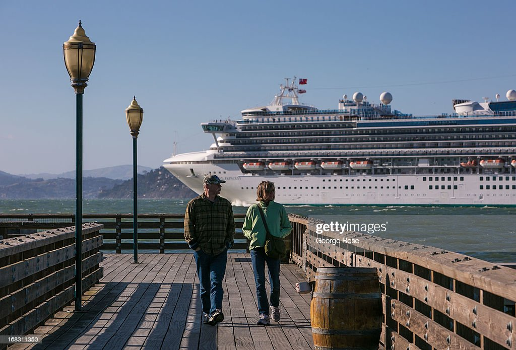 The oversized luxury cruise ship Sapphire Princess pulls out of Pier 35 after an overnight stop and heads for the Golden Gate Bridge on April 15, 2013, in San Francisco, California. Some 13.6 million international travelers visit the California each year generating nearly $100 billion in revenue and creating approximately 900,000 jobs in the arts, entertainment, recreation, food service and accomodations sectors.