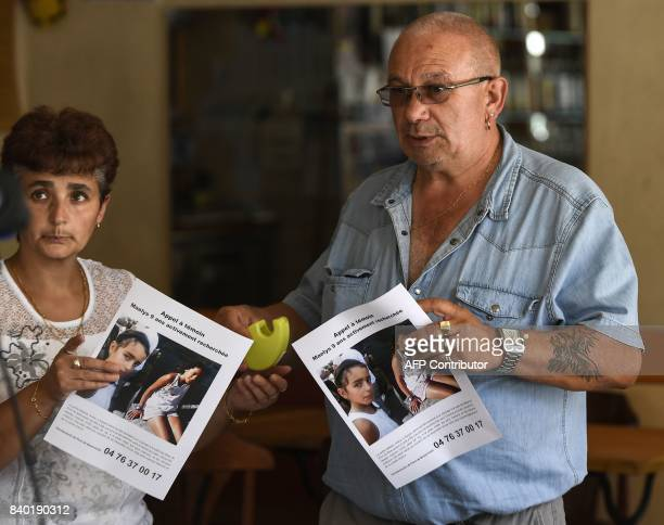 The owner of a bar and his employee hold missing posters issued by the Gendarmerie of PontdeBeauvoisin for Maelys a 9yearold girl who disappeared...