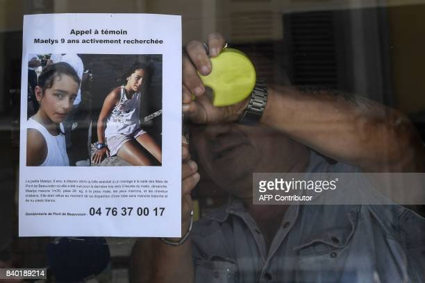 The owner of a bar attaches an appeal for witnesses poster issued by the Gendarmerie of PontdeBeauvoisin for Maelys a 9yearold girl who disappeared...