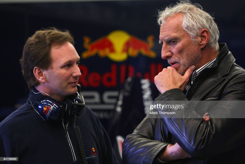 The owner of Red Bull Dieter Mateschitz of Austria and team Red Bull Racing team principal Christian Horner talk in the pits during Formula 1 testing...