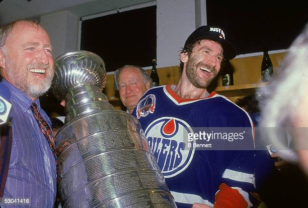 The owner of the Edmonton Oilers hockey team Peter Pocklington and Canadian hockey player Glenn Anderson celebrate their Stanley Cup victory over the...