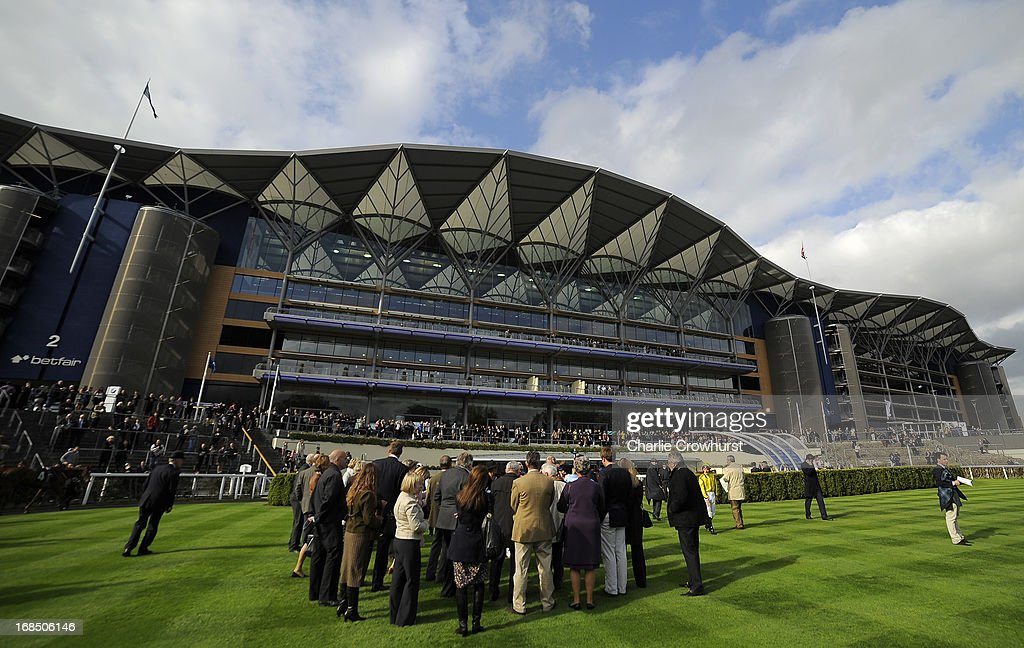 The owners and trainers wait in the parade ring at Ascot racecourse on May 10, 2013 in Ascot, England.