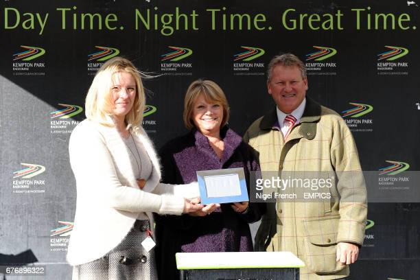 The owners of Jubail receive their prize after victory in the williamhillcom/mobile Juvenile Hurdle