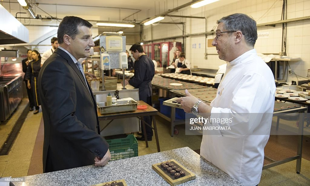 the owners of spanish restaurant uel celler de can rocau somellier josep roca l and his brother chef joan roca chat at the kitchen of the terrazas