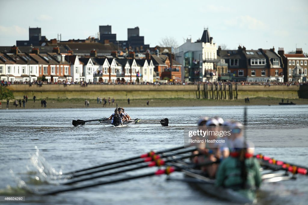 The Oxford and Cambridge Women's teams in action during the BNY Mellon Oxford v Cambridge University Boat Race 2015 on April 11 2015 in London England