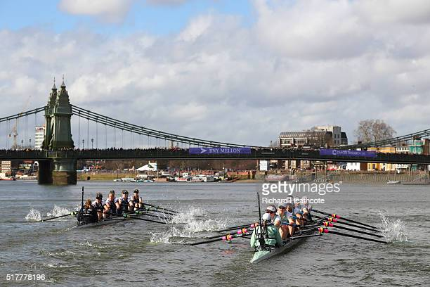 The Oxford boat leads the Cambridge boat as they approach Hammersmith Bridge during The Cancer Research UK Women's Boat Race on March 27 2016 in...