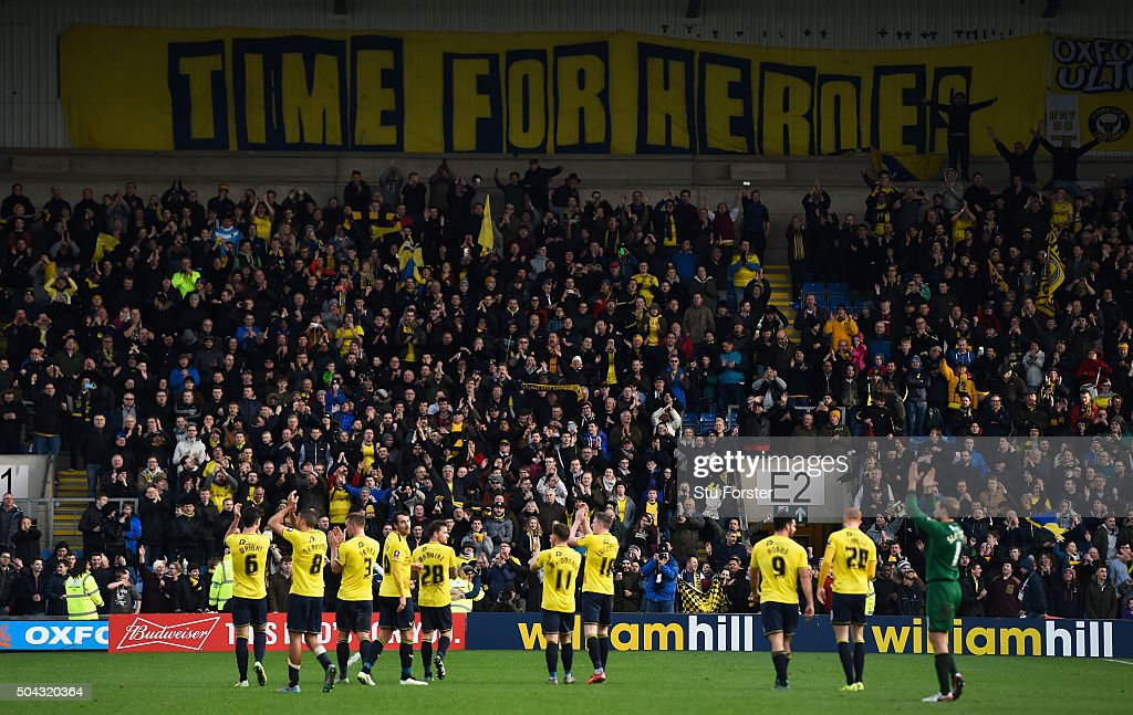 The Oxford players and fans celebrate following their team's 3-2 victory during The Emirates FA Cup third round match between Oxford United and Swansea City at the Kassam Stadium on January 10, 2016 in Oxford, England.