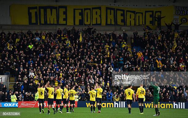 The Oxford players and fans celebrate following their team's 32 victory during The Emirates FA Cup third round match between Oxford United and...