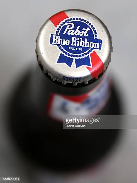 the Pabst Blue Ribbon logo is displayed on the cap od a bottle at a convenience store on September 22 2014 in San Francisco California Pabst Brewing...