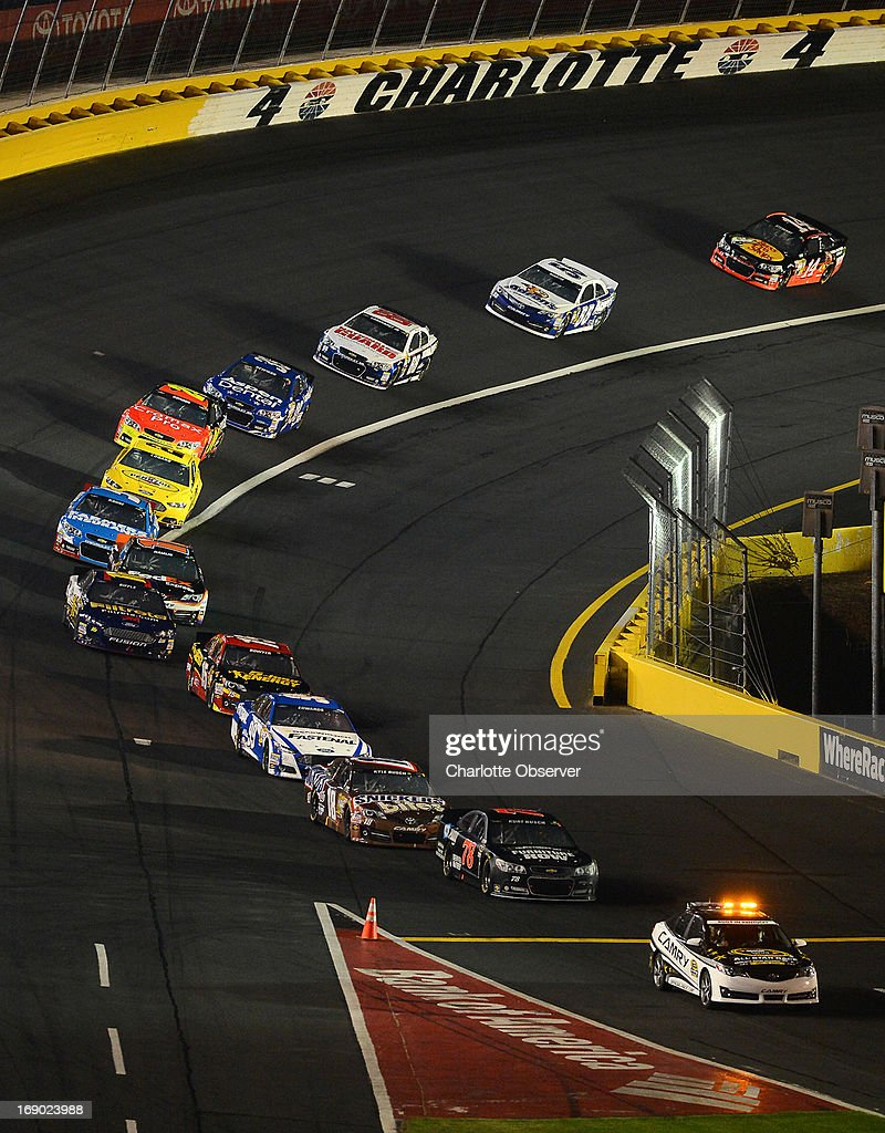 The pace car leads the field in the NASCAR Sprint All-Star race out of Turn 4 and onto pit road at Charlotte Motor Speedway on Saturday, May 18, 2013, in Concord, North Carolina. The race was red flagged at lap 13 due to rain.
