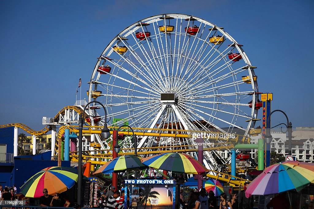The Pacific Park Ferris wheel stands on the Santa Monica Pier in Santa Monica, California, U.S., on Monday, Aug. 5, 2013. Overall U.S. tourism-related sales increased 6.8% in the second quarter of 2013 as compared to 2012. Photographer: Patrick Fallon/Bloomberg via Getty Images