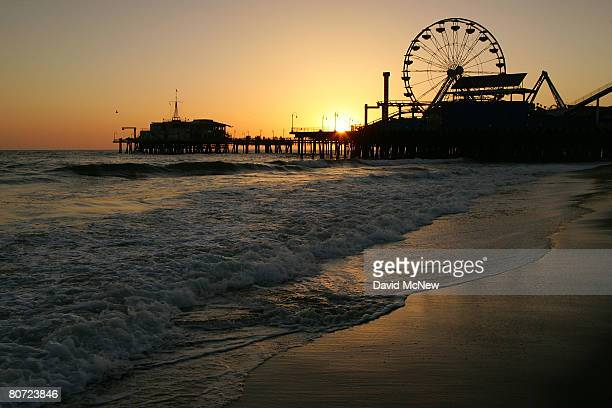 The Pacific Wheel Ferris wheel which has appeared in countless television shows feature films and commercials stands lit but idle on the Santa Monica...
