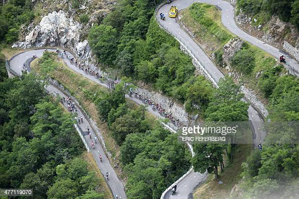 The pack climbs the Saint Andre hill during the 1565 km eighth and last stage of the 67th edition of the Dauphine Criterium cycling race on June 14...