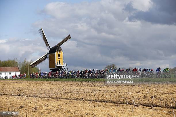 The pack compete in front of the Hubertus mill on April 17 2016 during the Amstel Gold Race in Beek / AFP / ANP / Bas Czerwinski / Netherlands OUT