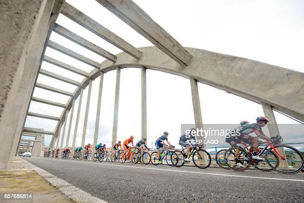 The pack crosses a bridge over the Ebro river on the sixth day of the 97th Volta Catalunya 2017 a 1897km stage from Tortosa to Reus in Mora D'Ebre on...