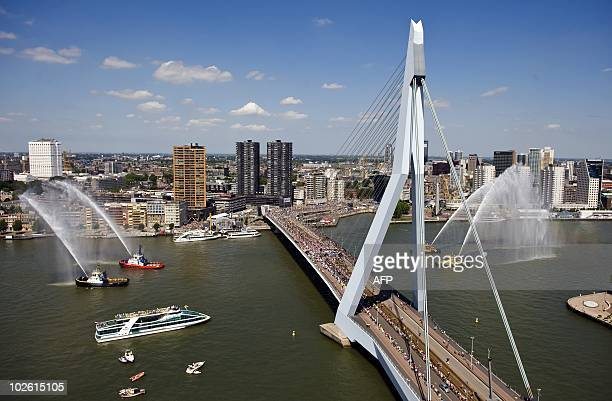 The pack crosses the Erasmus bridge in Rotterdam during the start of the first stage of the Tour de France on July 4 2010 for 22350 km long run from...