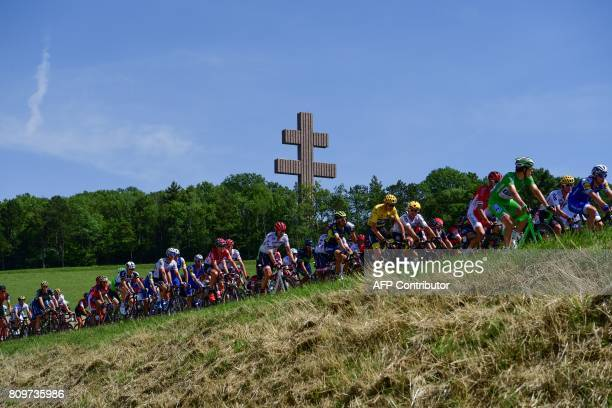 TOPSHOT The pack including Great Britain's Christopher Froome wearing the overall leader's yellow jersey and France's Arnaud Demare wearing the best...