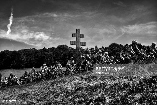 The pack including Great Britain's Christopher Froome wearing the overall leader's yellow jersey and France's Arnaud Demare wearing the best...
