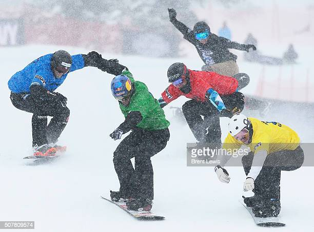 The pack of racers with Jarryd Hughes yellow come across the finish line during the men's ski cross finals at Winter X Games 2016 at Buttermilk...
