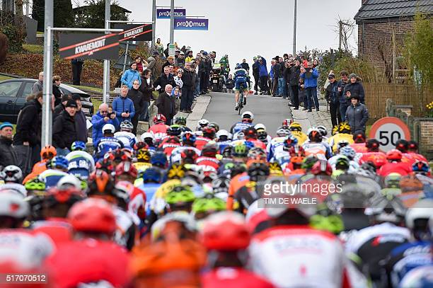 The pack of riders pedals during the 71st edition of the 'Dwars Door Vlaanderen' cycling race7 km from Roeselare to Waregem on March 23 2016 The...