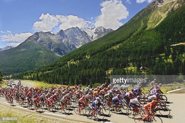 The pack of the 87th Tour de France ride through the Alps mountains during the sunny 15th stage of the French cycling race between Briancon and...