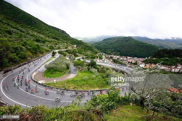 TOPSHOT The pack passes a curve on a mountain road during the 7th stage of 99th Giro d'Italia Tour of Italy from Sulmona to Foligno of 211 km on May...
