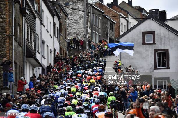 The pack ride at the Cote de SaintRoch during the 102nd edition of the LiegeBastogneLiege one day cycling race 256km with departure and arrival in...