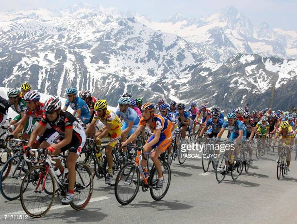 The pack ride in the mountains during the 6th stage of the 70th 'Tour de Suisse' cycling race between Fiesch and La Punt 15 June 2006 AFP PHOTO...