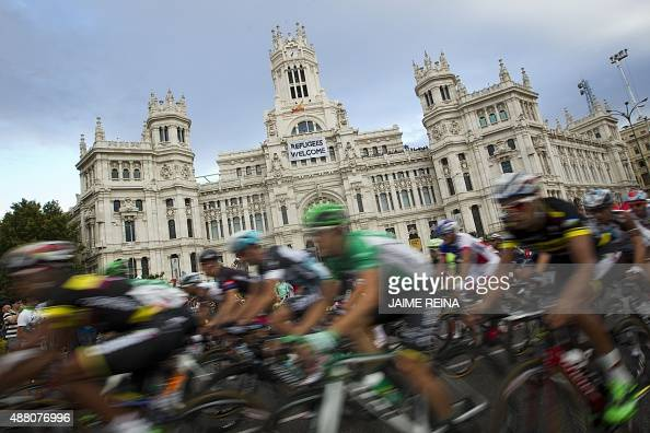 The pack ride past the Cibeles Palace during the las stage of the 70th edition of 'La Vuelta' Tour of Spain a 978 km route between Alcala de Henares...
