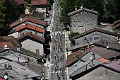 The pack rides across a village during the 160 km fifteenth stage of the 103rd edition of the Tour de France cycling race on July 17 2016 between...