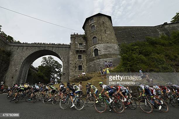 The pack rides at the Namur citadel during the 2235 km fourth stage of the 102nd edition of the Tour de France cycling race on July 7 between the...