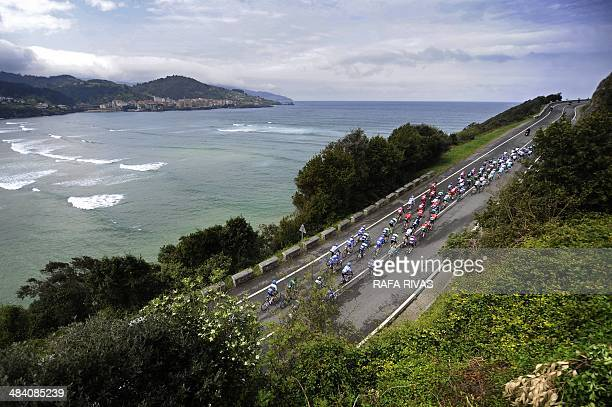 The pack rides by the seaside in Ibarrangelu during the fifth stage of the Tour of the Basque Country a 1602 km ride between Eibar and Markina in...