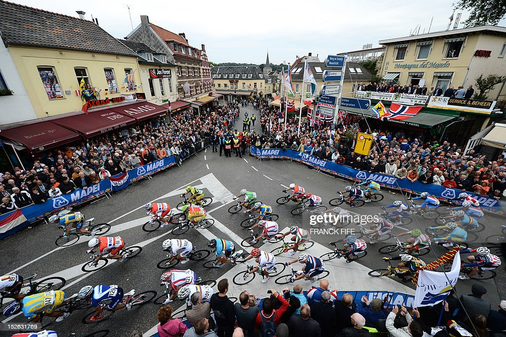 The pack rides during Men's Elite Race at the UCI Road World Championships on September 23, 2012 in Valkenburg. Philippe Gilbert of Belgium won the race ahead Edvald Boasson Hagen of Norway and Alejandro Valverde of Spain. AFP PHOTO / FRANCK FIFE