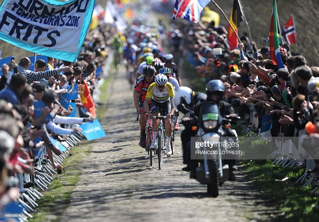 The pack rides during the 113th edition of the ParisRoubaix ParisRoubaix oneday classic cycling race on the section of the route known as the Trouee...