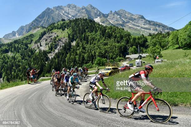 The pack rides during the 115 km eighth stage of the 69th edition of the Criterium du Dauphine cycling race on June 11 2017 between Albertville and...